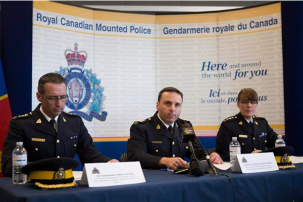 Canada federal and Royal Canadian Mounted Police officials conduct a press conference on Monday on the arrests of two men in connection with an alleged terror plot to derail a passenger train. AP photo