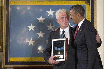 President Barack Obama stands with Ray Kapaun, nephew of Chaplain (Captain) Emil J. Kapaun, U.S. Army, as he awards the Medal of Honor posthumously to Chaplain Kapaun.