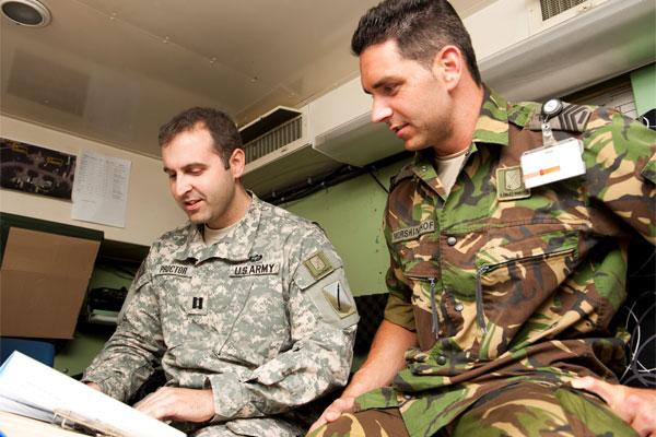 Army Capt. Adam Proctor with dutch soldier 600x400