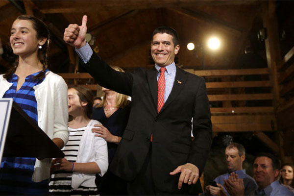 Republican candidate for the U.S. Senate Gabriel Gomez, center, gives a thumbs up as he takes to the stage next to his daughter Olivia, 13, left, before addressing an audience with a victory speech at a watch party, in Cohasset, Mass., Tuesday, April 30.