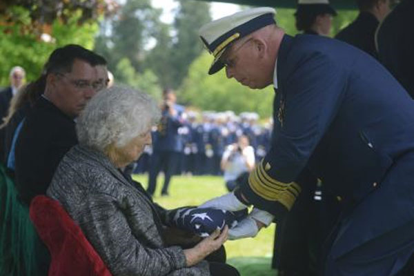 Coast Guard widow at funeral 600x400