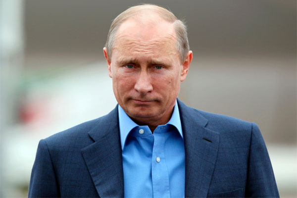 Russian President Vladimir Putin arrives at Belfast International Airport, in Northern Ireland, on Monday, June 17, 2013.