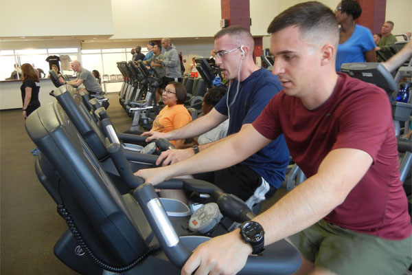Marines and civilians at fitness center 600x400