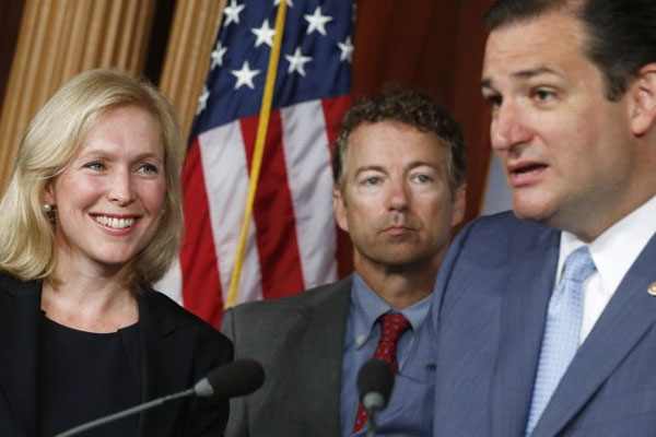 Sen. Kirsten Gillibrand, D-N.Y., left, smiles as she listens to Sen. Ted Cruz, R-Texas speak to reporters during a news conference about a bill regarding military sexual assault cases on Capitol Hill in Washington, Tuesday, July 16, 2013.