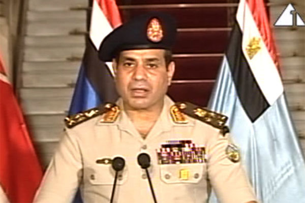 This image made from video shows Lt. Gen. Abdel-Fattah el-Sissi addressing the nation on Egyptian State Television Wednesday, July 3, 2013.