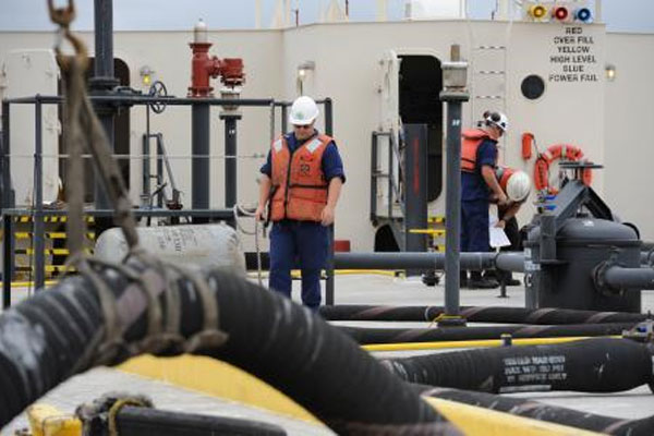 Coast Guard crew inspects oil barge 600x400