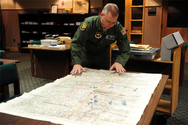 Lt. Col. Jenns Robertson researches 600x400