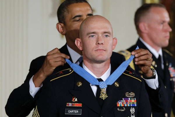 President Barack Obama awards US Army Staff Sgt. Ty M. Carter the Medal of Honor for conspicuous gallantry, Monday, Aug. 26, 2013.