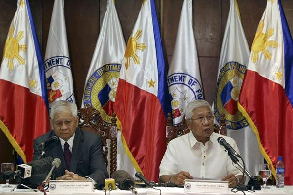 Philippine Defense Secretary Voltaire Gazmin, right, talks beside Foreign Secretary Albert del Rosario during a press conference at Camp Aguinaldo headquarters in suburban Quezon City, north of Manila, Philippines on Monday, Aug. 12, 2013. AP Photo