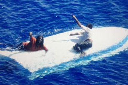 Two rescued from capsized vessel 428x285