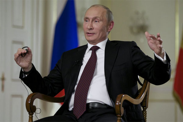 Russian President Vladimir Putin gestures while speaking to John Daniszewski, the Associated Press's Senior Managing Editor for International News, during an AP interview at Putin's Novo-Ogaryovo residence outside Moscow, Russia,