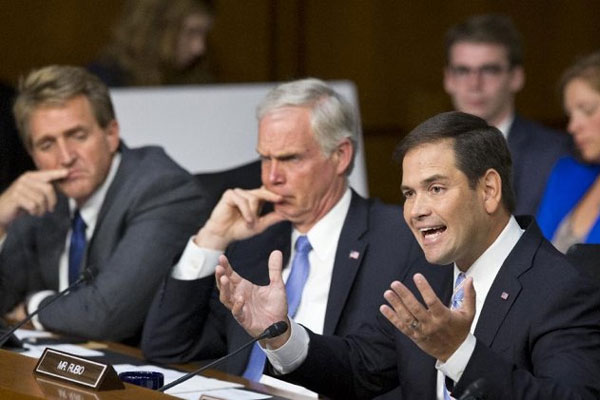 Senate Foreign Relations Committee member Sen. Marco Rubio, R-Fla., joined by fellow committee members, Sen. Ron Johnson, R-Wis., center, and Sen. Jeff Flake, R-Ariz