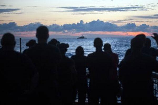 Crewmembers aboard Coast Guard Cutter Forward 600x400