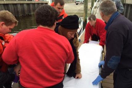 Coast Guard crew members rescue man