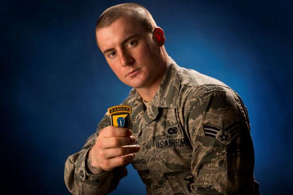 Senior Airman Stephen Becker holds a commanders coin