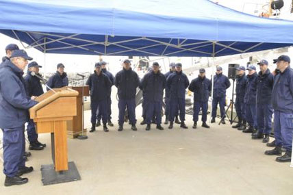 Rear Adm. Daniel Able, commander First Coast Guard District, addresses the crew of the 110-foot patrol boat Bainbridge Island during a ceremony at the cutter's pier in Bayonne, N.J., March 17, 2014.