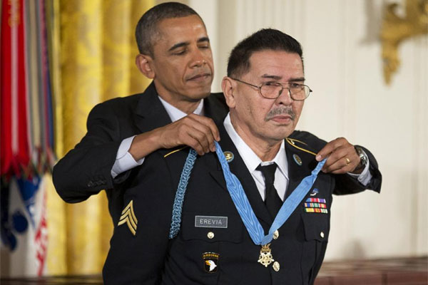 President Barack Obama awards Army Spc. Santiago Erevia the Medal of Honor during a ceremony in the East Room of the White House in Washington, Tuesday, March 18, 2014. (AP Photo/Manuel Balce Ceneta)