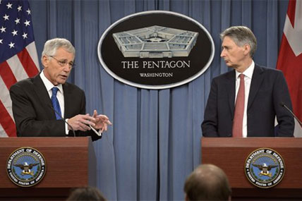 U.S. Defense Secretary Chuck Hagel, left, and British Defense Secretary Philip Hammond brief reporters during a joint news conference at the Pentagon, March 26, 2014. DOD photo by Glenn Fawcett