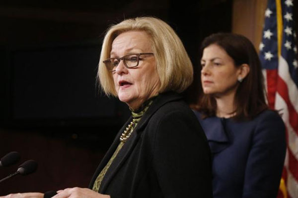 This March 6, 2014 file photo shows Sen. Claire McCaskill, D-Mo., left, and Sen. Kelly Ayotte, R-N.H. at a news conference on Capitol Hill in Washington. (AP Photo/Charles Dharapak, File)