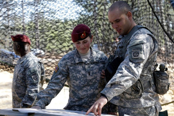 1st Lt. Kelly Requa speaks with Spc. Michael Cantrell of Bravo Battery, 321st Field Artillery at a fires direction center during certification on Fort Bragg, N.C. on Tuesday, Feb. 18, 2014.