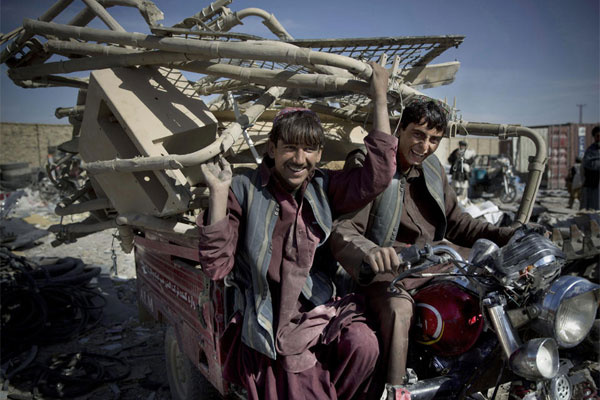 Afghan scrap collectors transport a load of U.S. destroyed equipment from the departing U.S. military inKandahar, southern Afghanistan.