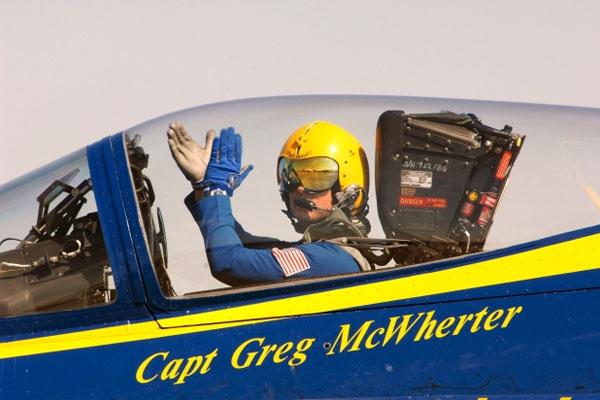 Capt. Greg McWherter, then-commanding officer and flight leader of the U.S. Navy flight demonstration squadron Blue Angels, responds to the crowd at the Guardians of Freedom Air Show in Lincoln, Neb., on Sept. 9, 2011.