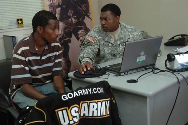 Staff Sgt. Roger L. Whaley speaks with Phillip McDonald about the possibility of becoming a journalist or X-ray technician at the U.S. Army Recruiting Station in Radcliff, Kentucky, in this September 2008 Army file photo.