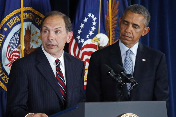 President Barack Obama listens as former Procter and Gamble executive Robert McDonald, his nominee as the next Veterans Affairs secretary, speaks at the Department of Veterans Affairs in Washington, Monday, June 30, 2014. (AP Photo/Charles Dharapak)