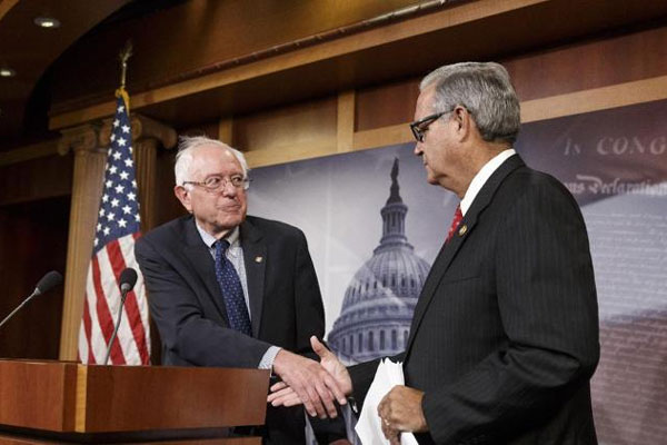 Senate Veterans' Affairs Committee Chairman Sen. Bernie Sanders, I-Vt., left, shakes hands with House Veterans' Affairs Chairman Rep. Jeff Miller, R-Fla., on Capitol Hill in Washington, Monday, July 28, 2014 (AP Photo/J. Scott Applewhite)