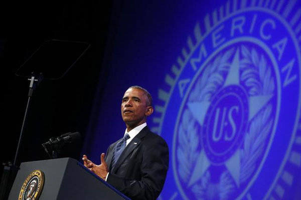 President Barack Obama speaks about veterans issues at the American Legion's 96th National Convention at the Charlotte Convention Center in Charlotte, N.C., Tuesday, Aug. 26, 2014.. (AP Photo/Charles Dharapak)