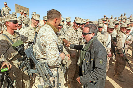 Actor-comedian Robin Williams shakes hands with Marines from 2nd Battalion, 9th Marine Regiment, during the USO's Holiday Troop Visit tour at Camp Hanson in Marjah, Afghanistan, in 2010.