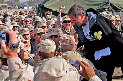Comedian Robin Williams shakes hands and banters with troops during his USO visit to Camp Liberty in western Baghdad. It was the second year in a row that Williams has made a pre-holiday visit to soldiers serving in Iraq. Sgt. Dan Purcell/Army