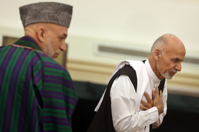 Outgoing Afghan President Hamid Karzai and incoming president Ashraf Ghani Ahmadzai. (Photo by Associated Press)