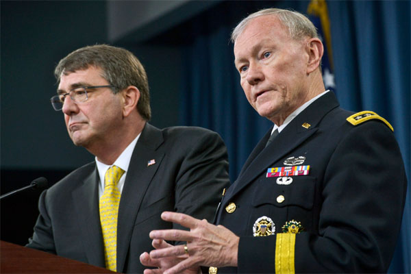 Army Gen. Martin E. Dempsey, chairman of the Joint Chiefs of Staff, answers a reporter's questions as Defense Secretary Ash Carter listens during a press conference at the Pentagon, May 7, 2015.  (DoD photo by Glenn Fawcett)
