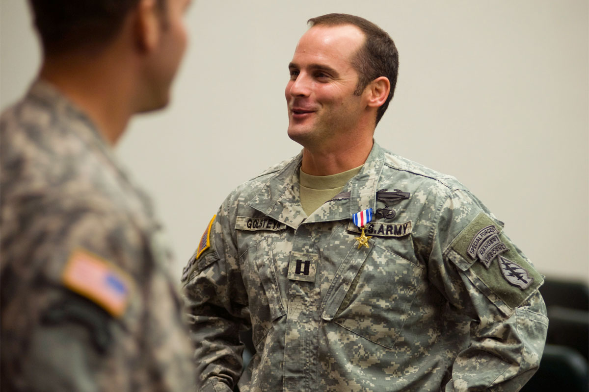 In this Jan. 4, 2011 file photo, U.S Army Capt. Mathew Golsteyn, right, is congratulated by fellow soldiers following the Valor Awards ceremony for 3rd Special Forces Group at Fo