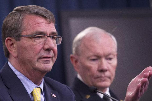 Defense Secretary Ash Carter, accompanied by Joint Chiefs Chairman Gen. Martin Dempsey, gestures during a news conference at the Pentagon, Wednesday, July 1, 2015. (AP Photo/Cliff Owen)