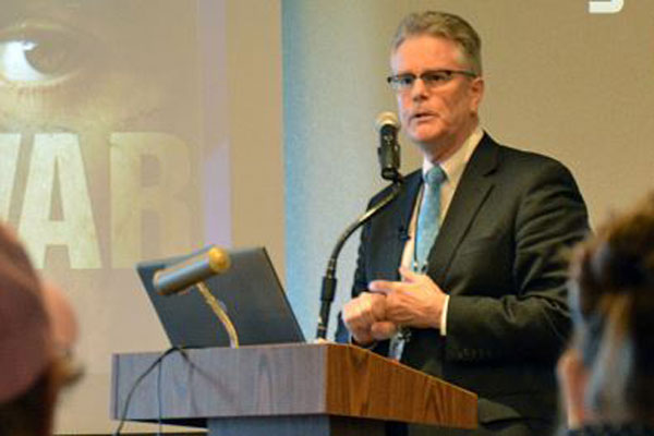 Dr. Terence Keane is shown in this 2012 VA photo speaking on the therapeutic value of the arts and literature in treating post-traumatic stress disorder.(Photo: Department of Veterans Affairs)