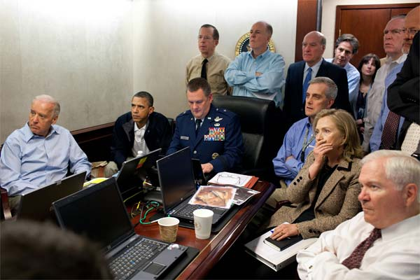 President Barack Obama and Vice President Joe Biden, along with members of the national security team, receive an update on the mission against Osama bin Laden in the Situation Room of the White House, Sunday, May 1, 2011 (White House)