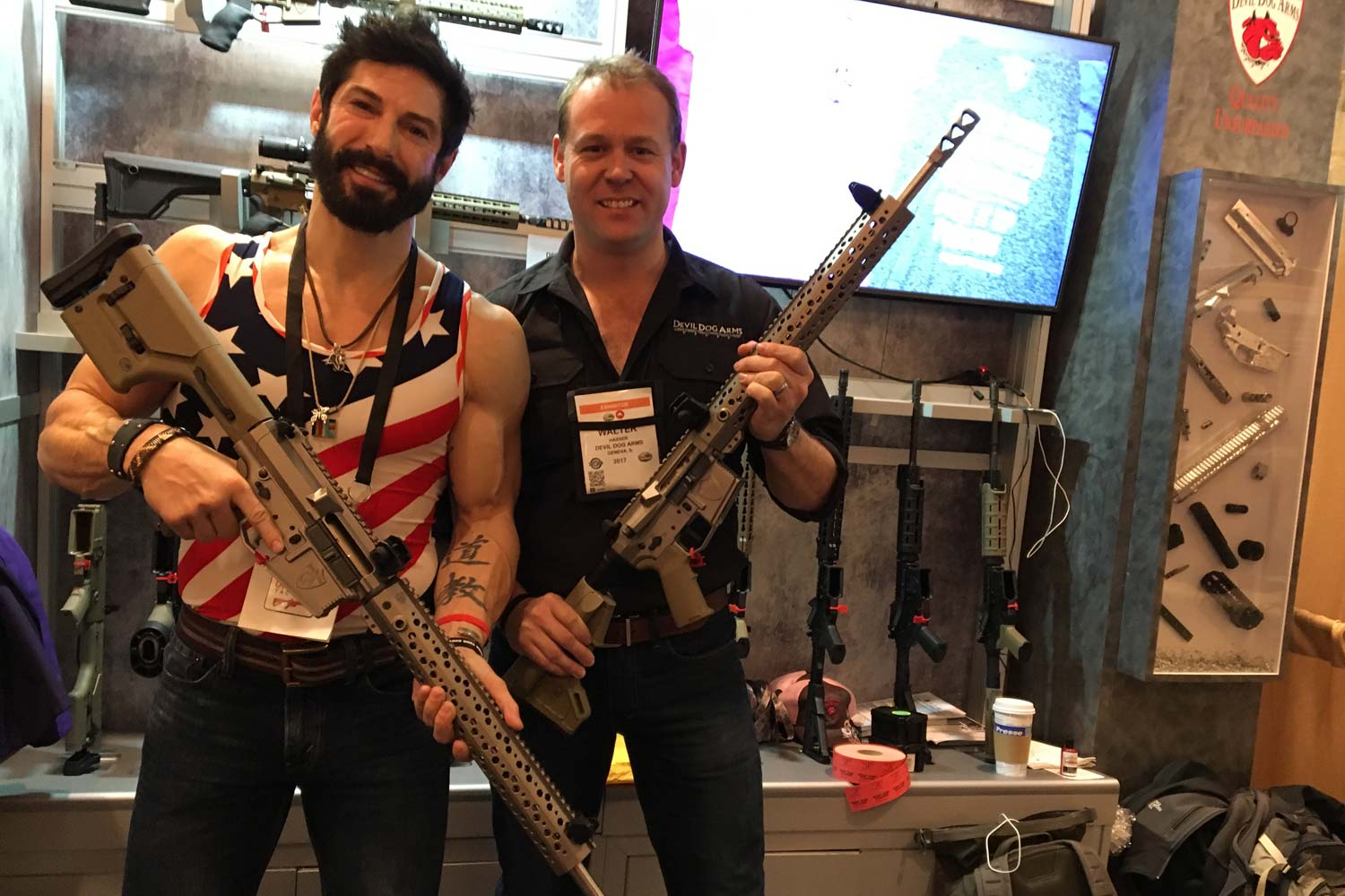 Rudy Reyes left and Walt Hasser right show off Devil Dog arms rifles. (Photo: Military.com/Hope Seck)