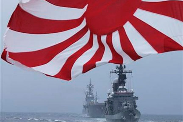 "Japan Maritime Self-Defense Force (JMSDF) escort ship ""Kurama"" leads other vessels during a fleet review in water off Sagami Bay, south of Tokyo, Sunday, Oct. 14, 2012."