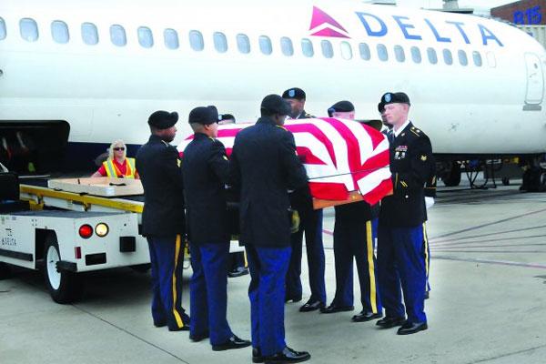 Flag draped coffin 600x400