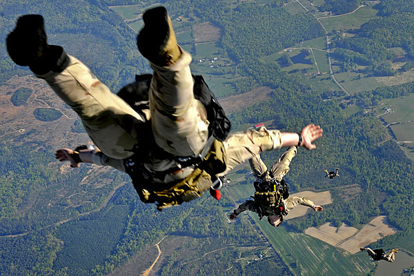 U.S. Air Force photo/Staff Sgt. Brian Ferguson. Navy SEALs make a practice jump.
