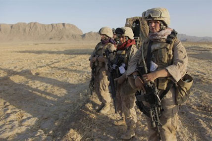 U.S. Marine Female Engagement Team members wait for the signal to begin their patrol in the Helmand Province of Afghanistan.