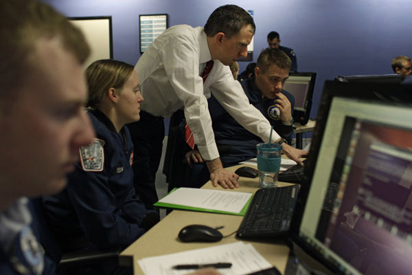 Martin Carlisle, standing, a computer science professor at the Air Force Academy and director of the school's Center for Cyberspace Research, instructs cadets in cyber warfare, at the U.S. Air Force Academy, in Colorado Springs, Colo.