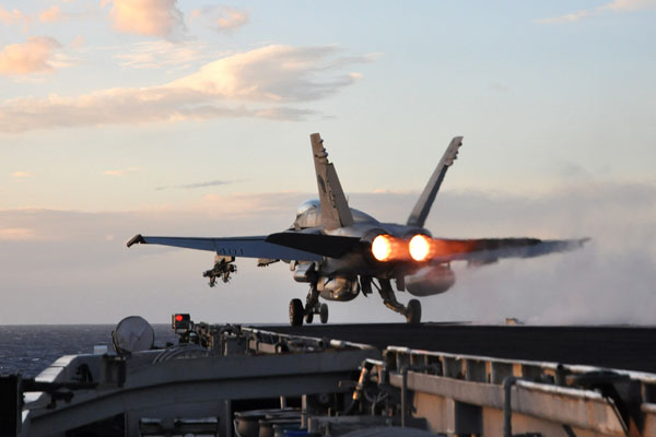 Navy officials said they plan to reduce deployments on aircraft carriers to eight months. (U.S. Navy photo)