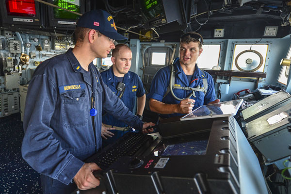 Ensigns Steven McGhan, right, and Phillip Gauronskas, left, conduct officer of the deck training while Lt. j.g. Timothy Davey, navigator of the guided-missile cruiser USS Monterey, observes. Navy photo by Mass Communication Specialist 3rd Class Billy Ho