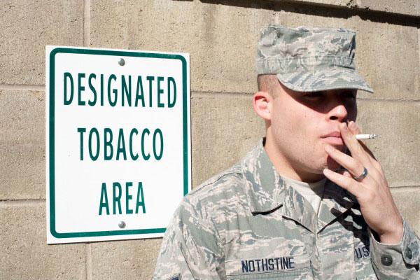 Soldier smokes a cigarette.