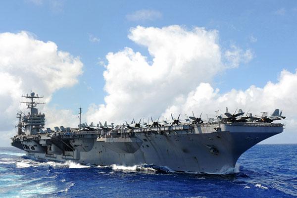 The Nimitz-class aircraft carrier USS Abraham Lincoln (CVN 72) transits through the Pacific Ocean in 2011. U.S. Navy photo by Mass Communication Specialist Seaman Adam Randolph