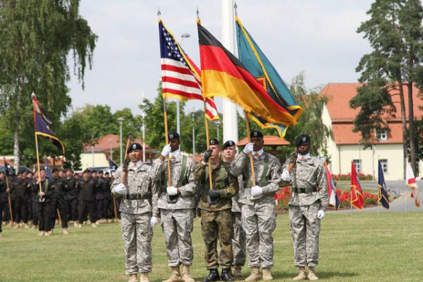 Soldiers from the 7th Army Noncommissioned Officer Academy comprise the color guard with German soldier Oberfähnrich Andre Potzler carrying the Federal Republic of Germany flag. (U.S. Army photo)