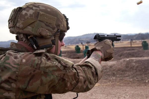 Soldier fires a pistol at the range.